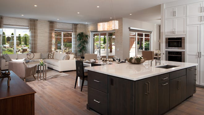 John and Carole Wooldrikpaid cash for this new 5,100-square-foot luxury condominium in the Enclave at Borgata in central Scottsdale.