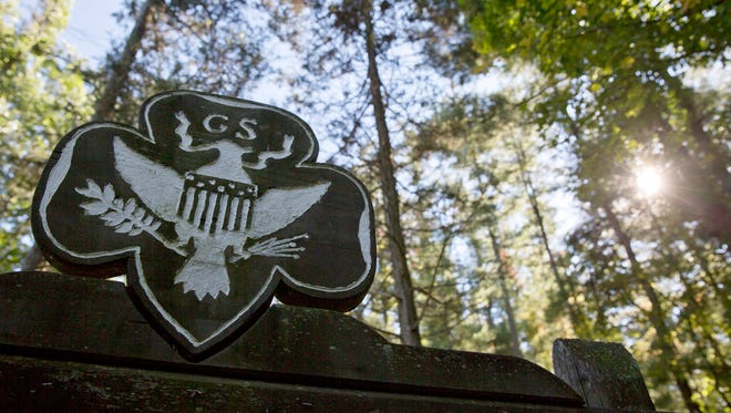 This Monday, Sept. 22, 2014 file photo shows the official Girl Scouts crest at the entrance of a Girl Scout Camp in Lapeer, Mich. As of March 2017, GSUSA reported 1,566,671 youth members and 749,008 adult members — down from just over 2 million youth members and about 800,000 adult members in 2014.