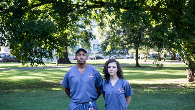 """August 24, 2017 - Bryan Goodman, left, and Cheryl Bird, right, led a group of UTHSC students in protesting the Forrest monument that stands in Health Sciences Park. Goodman, president of the Student National Dental Association, and Bird, vice president of the Student National Dental Association, are both fourth-year dental students and decided to take a stand against the statue. """"We really wanted to give everyone who is like minded the opportunity to show up and let everyone know that this is not something that we accept,"""" Goodman said."""