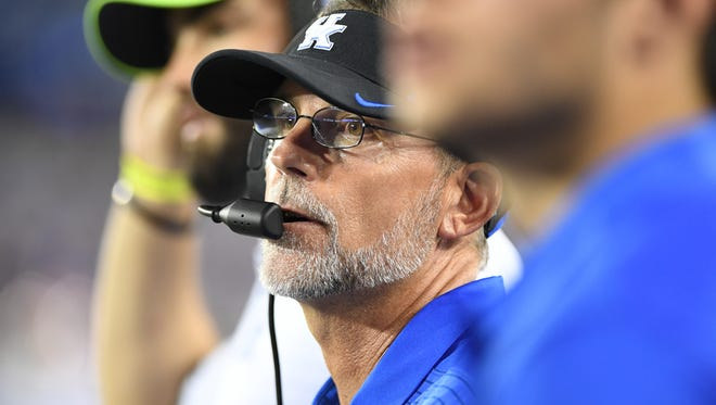 UK offensive coordinator Eddie Gran watches a kickoff during the University of Kentucky football game against University of Florida in Lexington, KY on Saturday, September 23, 2017.