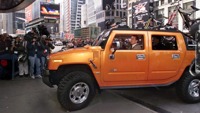 Arnold Schwarzenegger drives a 2001 concept Hummer H2 sport utility truck through Times Square, for the its New York debut, April 10, 2001.