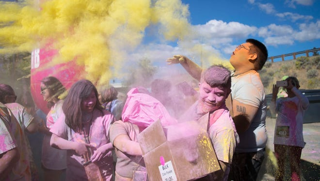 Runners participate in the Color Me Rad run on Saturday, Sept. 30, 2017. Reno, Nev.