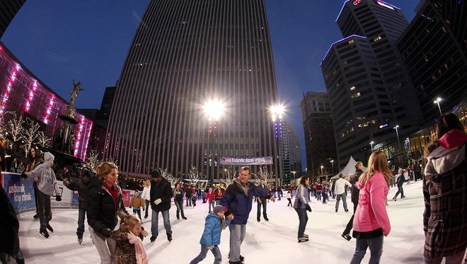 The ice skating rink on Fountain Square draws families, young couples, children, skilled skaters and some who spend a lot of time polishing the ice with the seat of their pants.