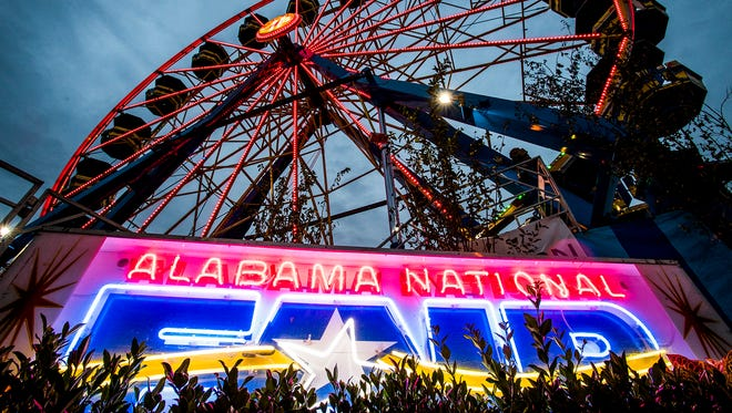 Fair goers enjoy the Alabama National Fair in Montgomery, Ala. on Wednesday November 1, 2017.