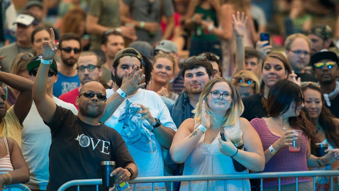 Fans cheer as Talib Kweli performs at Dogfish Head's Analog-A-Go-Go festival last fall at Bellevue State Park.
