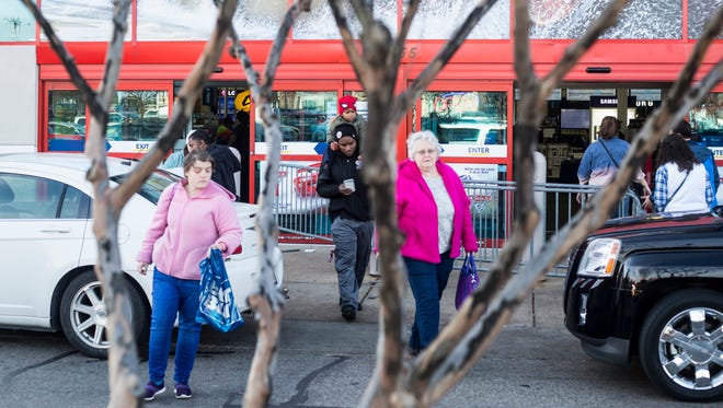 November 24, 2017 - Customers walk out of Best Buy after shopping on Black Friday. With online sales and box stores one-upping each other with earlier and earlier opening times, the traditional Black Friday morning shopping spree was a more subdued one in Memphis Friday morning.Ê