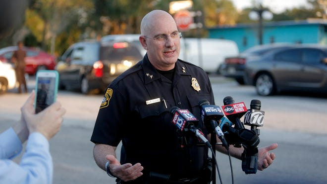 Tampa Police Chief Brian Dugan holds a news conference in a parking lot behind the Ybor City McDonalds on Tuesday, Nov. 28, 2017, in Tampa, Fla. Police were questioning an employee at the McDonald's in Ybor City about a gun he brought to the restaurant.