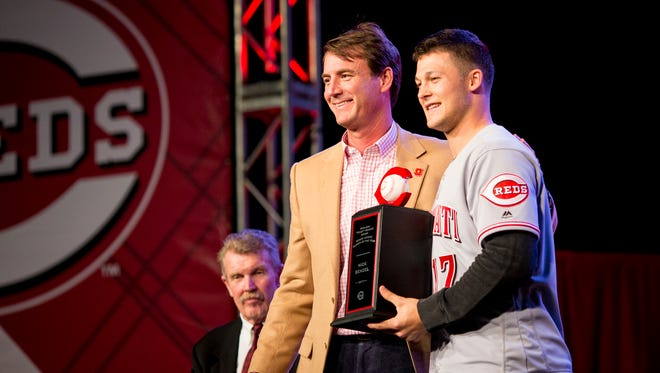 """Cincinnati Reds general manager Dick Williams  presents Cincinnati Reds minor leaguer Nick Senzel the Sheldon """"Chief"""" Bender Award as the organizations Minor League Player of the Year at Redsfest at the Duke Energy Convention Center in downtown Cincinnati Friday, December 1, 2017."""