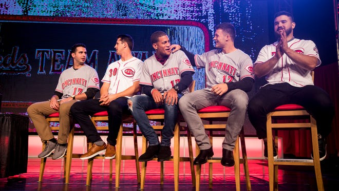 Cincinnati Reds minor leaguers Aaron Fossas, Tyler Mahle, Jose Siri and Nick Senzel wait with Cincinnati Reds third baseman Eugenio Suarez for the player awards at Redsfest at the Duke Energy Convention Center in downtown Cincinnati Friday, December 1, 2017.