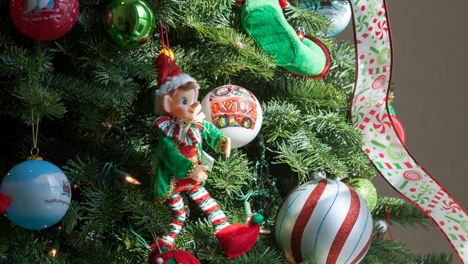 Ornaments created by participants in the Art Therapy Program at Riley Hospital for Children at IU Health in Indianapolis decorate the tree in the foyer.