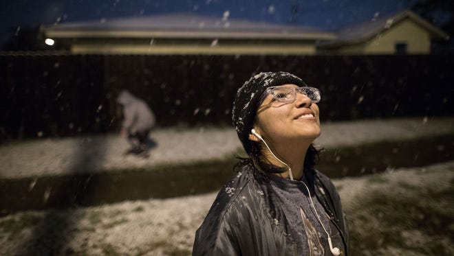Eva Cantu, 13, sees her first snowfall in Corpus Christi, Texas, on Friday, Dec. 8, 2017. This is the first accumulation of snow in Corpus Christi since 2004.