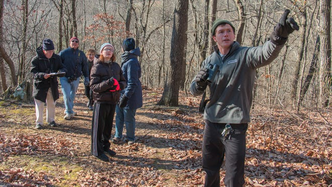 Park naturalist Andrew Wolfgang points out a red-headed woodpecker at Richard M. Nixon County Park Nature Center on Dec. 28, 2017.