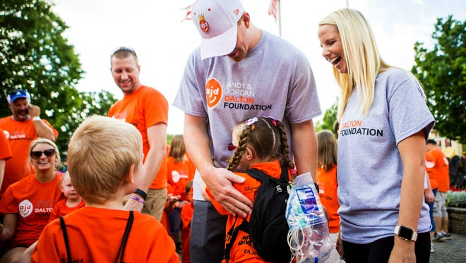 Bengals quarterback Andy Dalton, center, and his wife Jordan, right, could host 250 families for their Kings for a Day event at Kings Island thanks to donations from Buffalo Bills fans after the Bengals beat the Ravens on Dec. 31, sending the Bills to the playoffs.