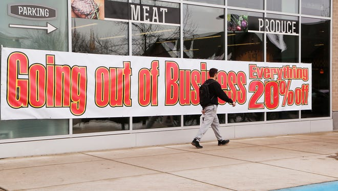 A man walks past Fresh City Market Tuesday, January 9, 2018, across from Mackey Arena in West Lafayette. The grocery is going out of business and is featuring 20 percent discount throughout the store.
