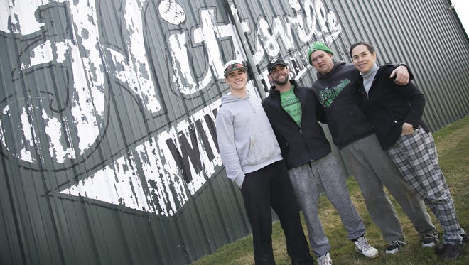 The Staab bunch (left to right) Thomas, Joe, Rusty and Jennifer pose in front of Hittsville, a metal building used for winter baseball.
