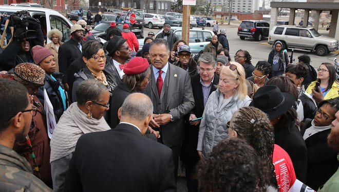 Jesse Jackson speaks at former site of a Kroger store in the Walnut Hills, Ohio, neighborhood of Cincinnati on Tuesday, April 10, 2018. Jackson had called for a boycott of Kroger as it closes stores in some minority communities.