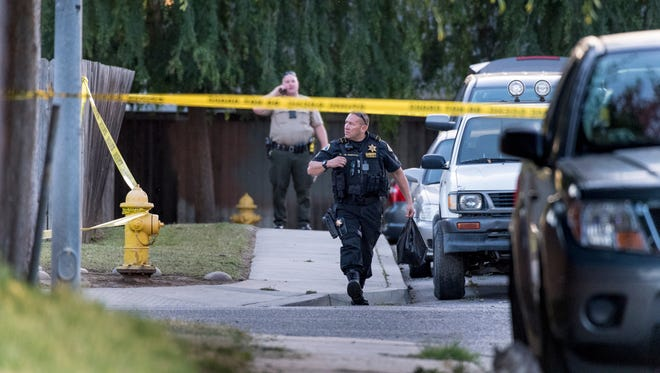 Tulare County Sheriff and Visalia Police departments investigate an officer involved shooting on Dennison just east of Road 124 in Orosi on Thursday, May 3, 2018.