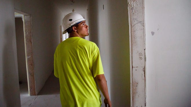 Zachary Hageman, 18, is part of a cleanup crew at Cityville in Des Moines, an entry-level position that's part of a new school program designed to give hands-on experience to high school students and recent graduates.