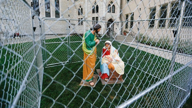 "A scene of Joseph, Mary and Baby Jesus on the lawn of Monument Circle's Christ Church Cathedral on Tuesday, July 3, 2018. ""I've had wonderful conversations with people passing by asking what does that mean and watching them figure it out. We have a hashtag #everyfamilyisholy even those families who are being detained. Those families are coming to us for safety and seeking a better life for their family. The Holy Family is that family and we want to let everyone know that every family is holy,"" Senior Pastor Stephen Carlsen said."