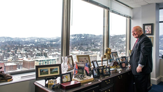 Glenn Wilcox Sr., owner and founder of Wilcox Travel and World Tours, stands in his office on the top floor of downtown Asheville's BB&T building on Tuesday. Wilcox, 83, started work in the building before the air conditioning was switched on and the top floors finished.
