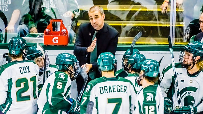 MSU Head Hockey Coach Tom Anastos speaks to his team during a timeout in their game with Minnesota Friday.