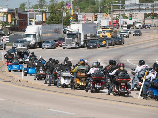 Riders make a left hand turn on to North George Street from Route 30 during the Ride Across America stop at 1st Capital Harley Davidson in Manchester Township.