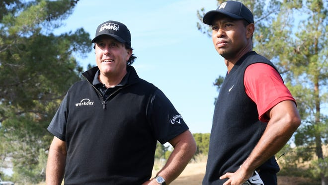 Tiger Woods and Phil Mickelson await the start of The Match at Shadow Creek Golf Course in Las Vegas on Nov. 23, 2018. The sequel, also starring Tom Brady and Peyton Manning, is set for Sunday at the Medalist Golf Course in Hobe Sound, Florida.