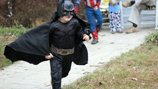 A scene from last year's Halloween celebration in West Asheville's Vermont Avenue.