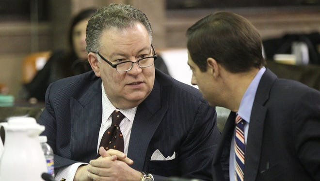 Dr. Joe Carbone and E. Daniel Quatro in a discussion  during the County Legislature meeting.  Legislature officials were discussing the county budget.