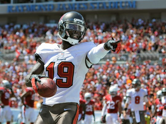 FILE - In this Sept. 29, 2013 file photo, Tampa Bay Buccaneers wide receiver Mike Williams (19) celebrates after catching a first quarter touchdown pass from quarterback Mike Glennon during the first quarter of an NFL football game against the Arizona Cardinals, in Tampa, Fla. The Buffalo Bills have acquired receiver Mike Williams in a deal with the Buccaneers. It's a homecoming for Williams, who grew up in Buffalo and played at Syracuse under current Bills coach Doug Marrone. (AP Photo/Brian Blanco, File)