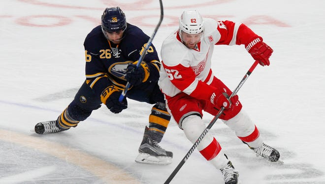 Sabres forward Matt Moulson defends Red Wings forward Thomas Vanek during the third period of the Wings' 2-1 win in a shoot-out Wednesday, Nov. 23, 2016 in Buffalo, N.Y.
