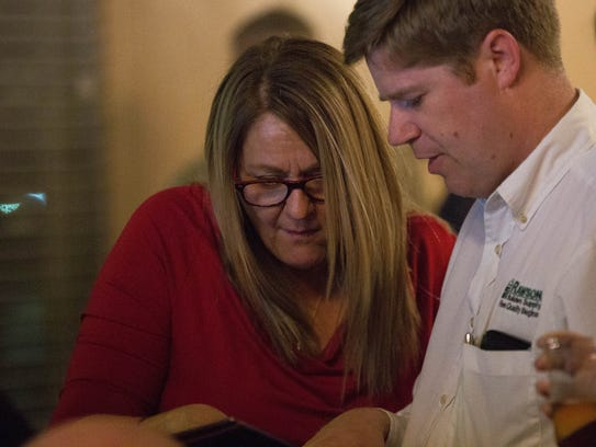 Bev Courtney, candidate for Las Cruces City Council district 3 seat talks with Benjamin Rawson, county commissioner for district 3 as poll numbers start to come in. At a watch party for Courtney and Ceil Levatino at Sunset Grill, Tuesday November 7, 2017.