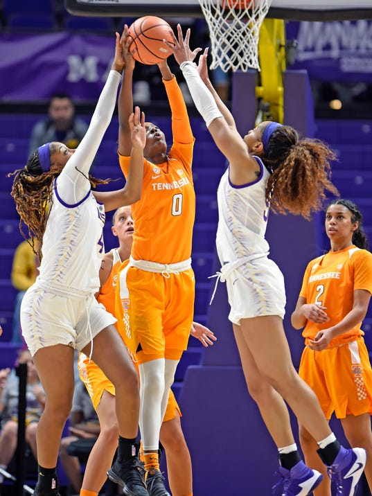 Tennessee guard Rennia Davis (0) battles for a rebound between LSU forward Raven Farley, left, and forward Ayana Mitchell, right, in the first half of an NCAA college basketball game, Sunday, Jan. 28, 2018, in Baton Rouge, La. LSU won 70-59. (AP Photo/Bill Feig)