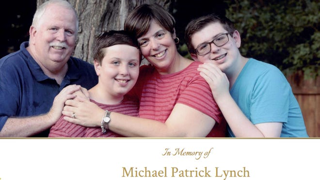 Michael Lynch, 14, right, pictured with his family. Lynch died in April, two weeks after he was struck by a car as he walked to school.