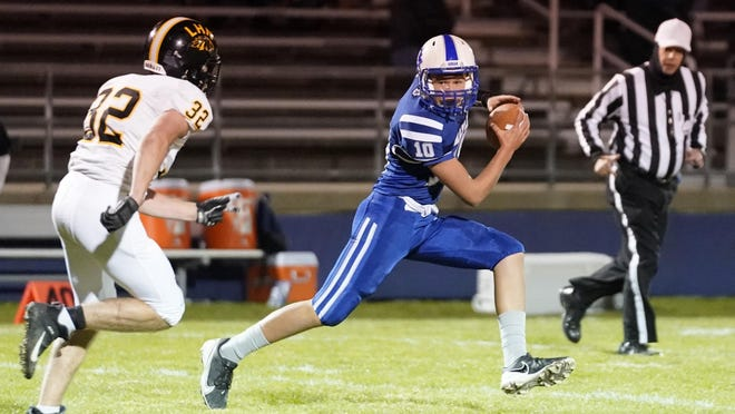 Adrian quarterback Sean Parker scrambles during Friday's game against Lutheran Northern.