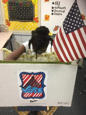 Peabody Montessori Elementary students voted for president on iPads in voting booths made from cardboard boxes during a district-wide mock election.