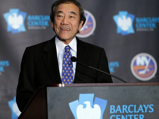 """FILE - This is an Oct. 24, 2012, file photo,  showing New York Islanders owner Charles Wang addressing the media during a press conference at Brooklyn's Barclays Center. The New York Islanders have announced that the team is being sold to a former Washington Capitals co-owner and a London-based investor. In a statement Tuesday, Aug. 19, 2014, the team says a group led by former Capitals co-owner Jon Ledecky and investor Scott Malkin has reached an agreement to buy a """"substantial"""" minority interest in the team. (AP Photo/Kathy Willens, File)"""