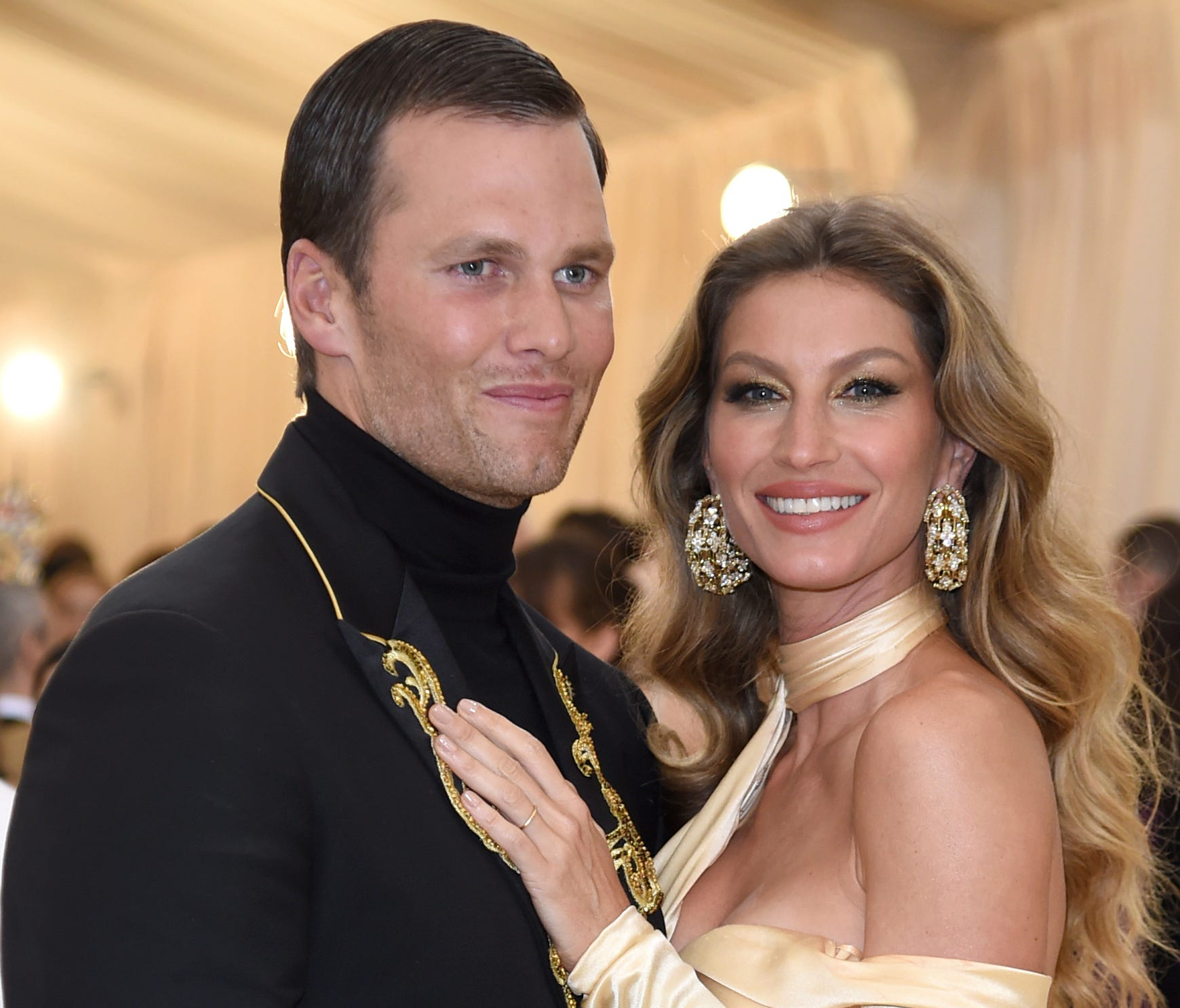Tom Brady, left, and Gisele Bundchen attend The Metropolitan Museum of Art's Costume Institute benefit gala celebrating the opening of the Heavenly Bodies: Fashion and the Catholic Imagination exhibition.