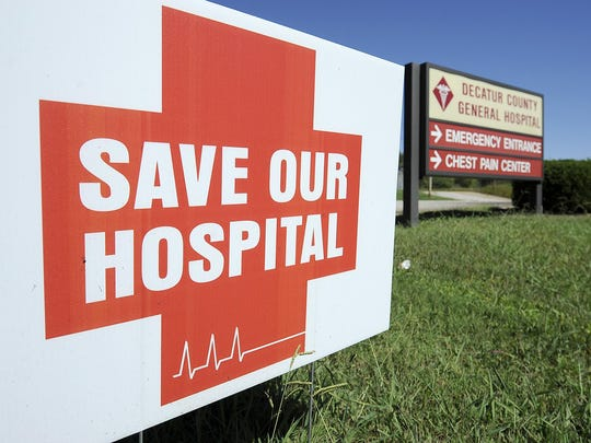 """A """"Save Our Hospital"""" sign is seen in front of the Decatur County General Hospital sign in Parsons on Tuesday."""