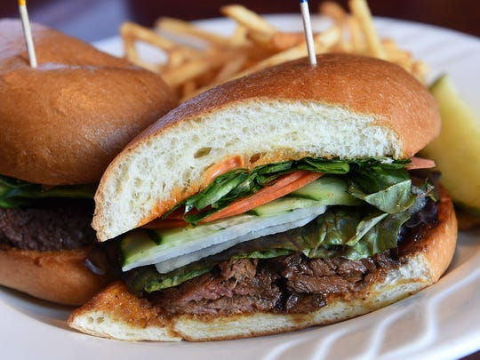 The banhi mi sandwich is filled with Vietnamese barbecued beef, daikon radish, carrots, cucumber, mint and jalapeños and swiped with sriracha mayonnaise.