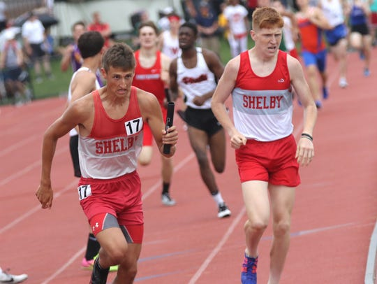 Shelby's Caleb Brown hands off the baton to Blake Lucius
