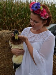 A visitor gives a docile duck some TLC at the festival's