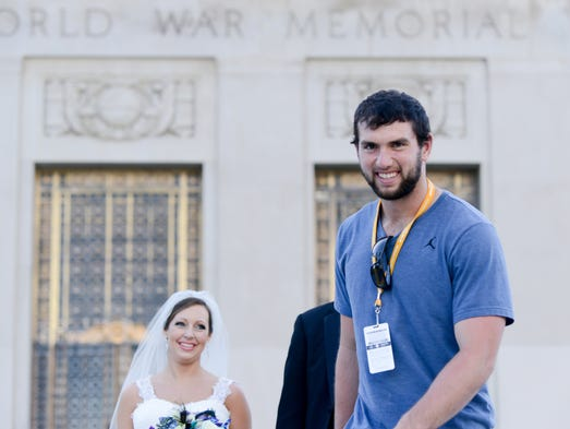 Newlyweds Madeline and Jason (last names withheld by request) got the wedding photos of a lifetime on Sunday when Colts quarterback Andrew Luck happened to pass by. When they asked Luck to join them for photos in front of the Indiana War Memorial in downtown Indianapolis, he obliged.