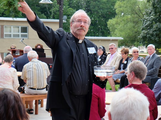 Father Dave Beaudry blesses Silver Lake College's new