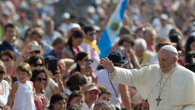 Pope Francis arrives Sept. 10, 2014, to hold his weekly general audience in St. Peter's Square, at the Vatican.