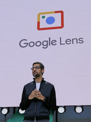 Google CEO Sundar Pichai talks about Google Lens, which lets you point your phone's camera at places and objects to get information about them.