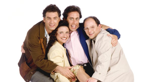 Michael Richards (from left) as Cosmo Kramer, Julia Louis-Dreyfus as Elaine Benes, Jerry Seinfeld as Jerry Seinfeld, and Jason Alexander as George Costanza.