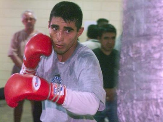 Erik Morales works out witr Friday afternoon at the
