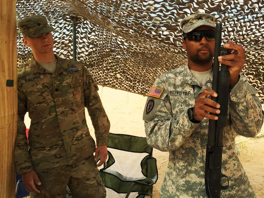 Sgt. Jared Royster, right, practices assembling the