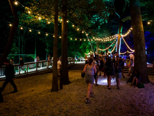 Firefly attendees make their way through The Pathway at the Firefly Music Festival in Dover on Saturday.